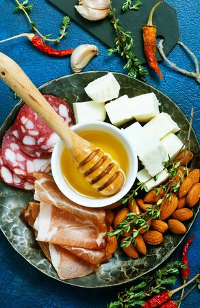 antipasti on white plate and on a table
