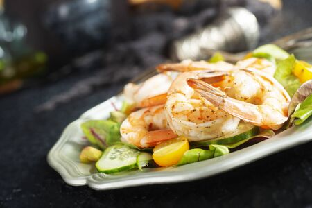 fried shrimps with fresh salad on plate