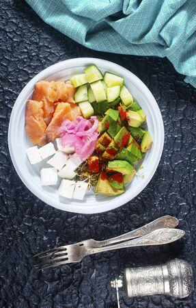 salad with avocado salmon feta, diet food