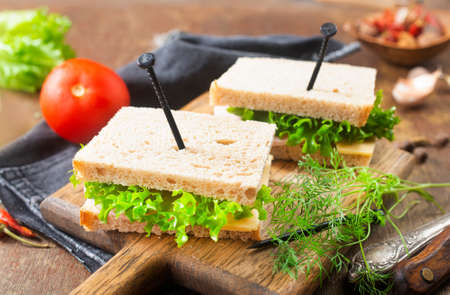 club sandwich- toasted sandwich with ham, tomato, lettuce and cucumber Banque d'images