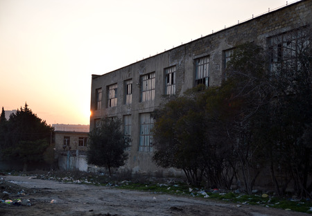Abandoned industrial building during sunset Stock Photo