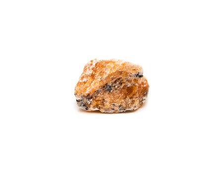 Orange calcite mineral isolated on white background