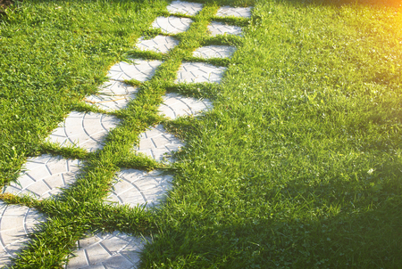 Pathway maden from paving stone in garden with beautiful lawn Stok Fotoğraf - 98424262