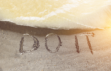 Words do it written on the river sand, conceptual text Stock Photo