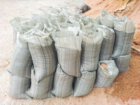 Sacks with building materials - sand and gravel, arranged in a row