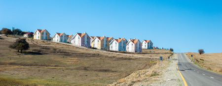 Row of newly built houses in suburban village view