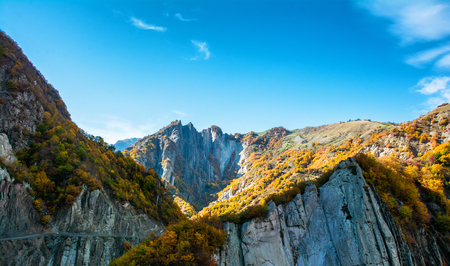Incredible landscape - view of the mountain range with yellowed trees and gorges