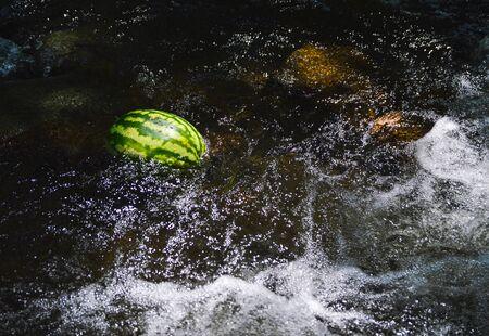 Watermelon in a river water stream