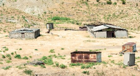 Abandoned farm buildings in the steppe