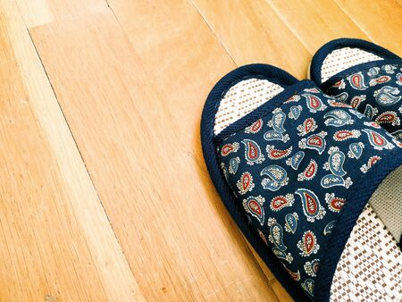 Home slippers on the parquet background