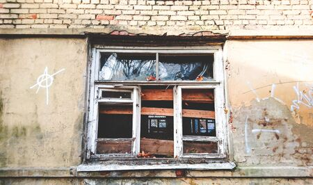Windows with broken glass of an abandoned building 写真素材