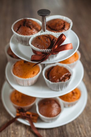 vitrine: Different muffins in a vitrine. Chocolate and white muffins.