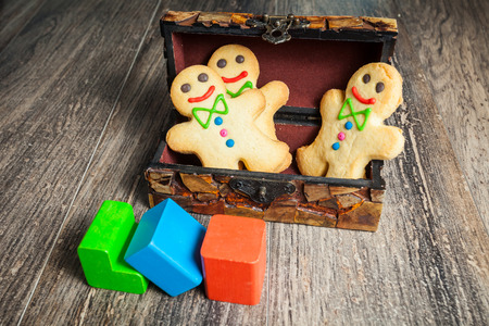 Gingerbread in the form of little man. Sweet home cookie photo
