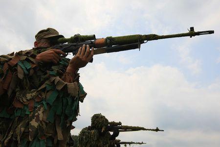 berets:   Ukrainian special troops soldiers  pass maroon berets exam  Stock Photo