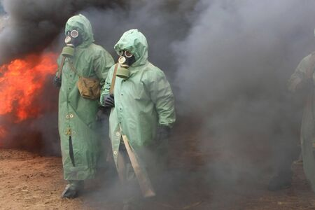 Two soldiers in chemical protection suites. Stock Photo - 3526487