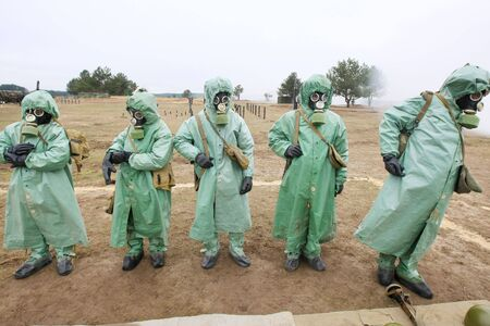 soldiers dress chemical protection suites. Stock Photo - 3664901
