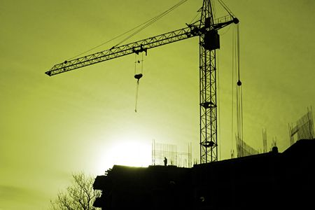�onstruction activity. Silhouette of construction worker           photo