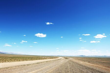 Desert road  in Mongolia with dramatic sky Stock Photo - 4194026
