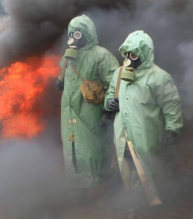 Two soldiers in chemical protection suites. photo