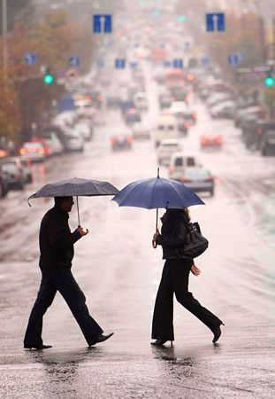 urban people cross the street on the rain Stock Photo