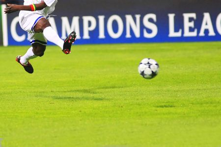 Flying soccer player during the soccer match Stock Photo - 4498250