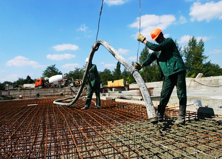 foundation problems: Construction workers laying of the foundation                                 Stock Photo