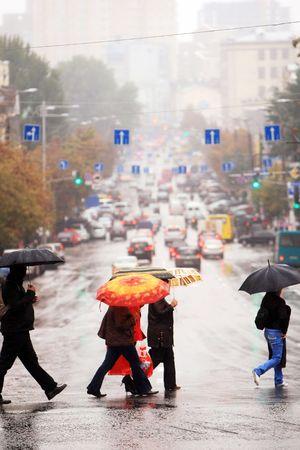 urban people cross the street in the rain photo