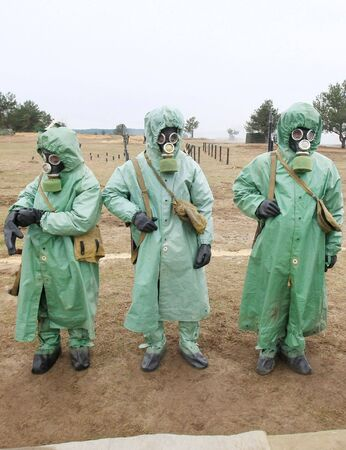 soldiers dress chemical protection suites. Stock Photo - 5012926