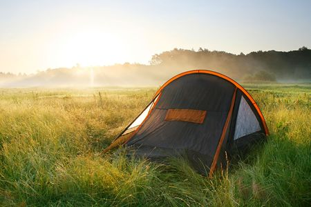 recreational area: tourist tent  in the sunrise