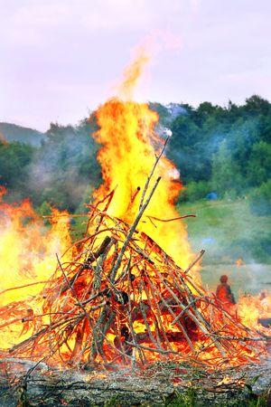 very big burning bonfire in the Carpathian Mountains photo