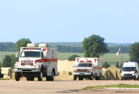 emergency lane: Emergency ambulance driving fast Stock Photo