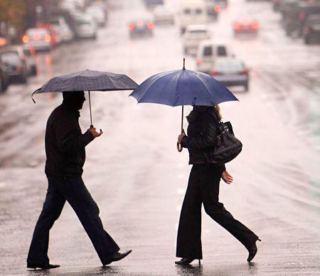 urban people cross the street on the rain photo