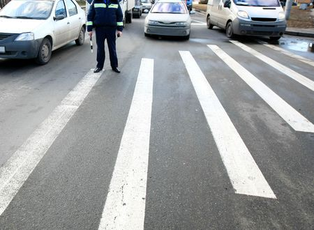 policeman on a crosswalk in the city Stock Photo - 5639625