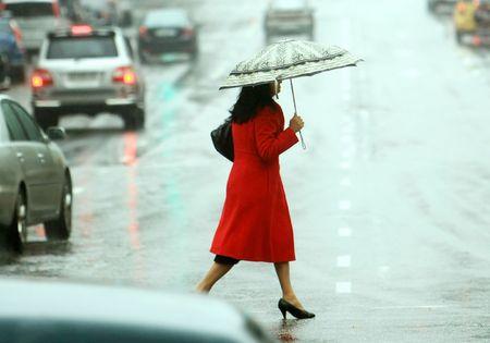 women cross the street on the rain photo