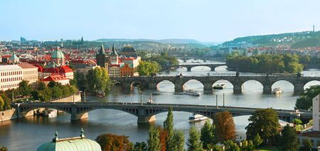 The skyline of Prague at sunset (Czech Republic) photo