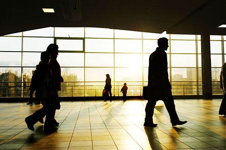 City people walking in a futuristic tunnel