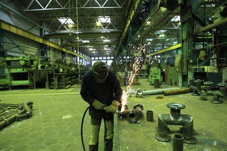 Welder welding a metal part in a dark industrial environment. Stock Photo - 5778967