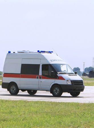 Emergency ambulance driving fast photo