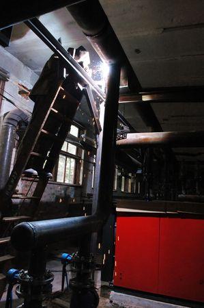 Welder welding a metal part in a dark industrial environment Stock Photo - 5806607
