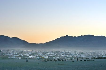 nomadism: Traditional mongolian village at sunset