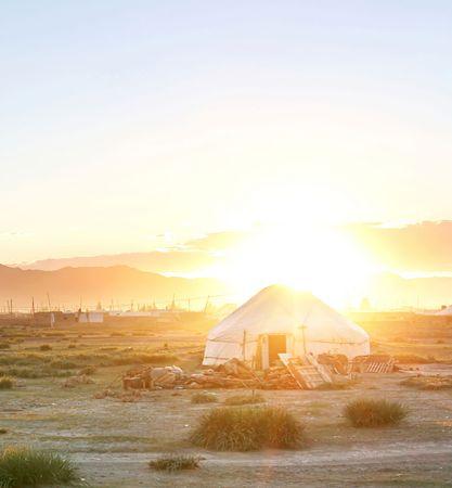 Traditional mongolian yurt in the sunet photo