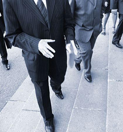 crossing legs: Businessmans went up  stairs. businessmens on their way to the office