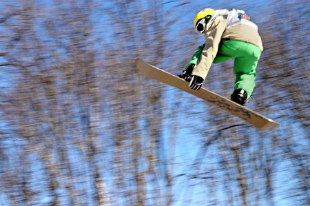 A snowboarder going big high above the half pipe Stock Photo - 6098751