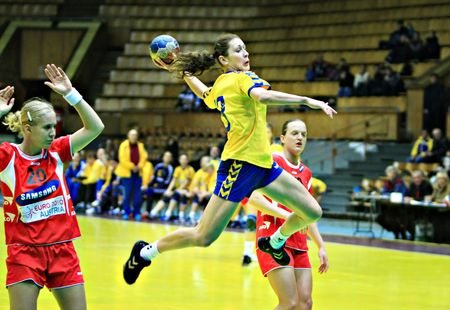 Kyiv , Ukraine-November 23, 2007-A high point of the match between Ukrainian and Austrian handball teams within the Turchynov Cup International Handball Tournament for women handball players Editorial