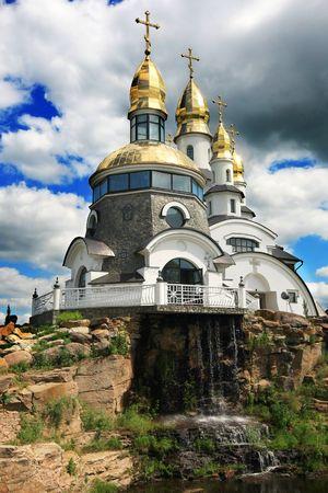 pompous:  Christian church against pompous sky