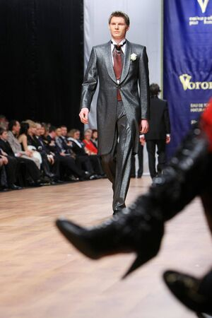 A model walks the runway demonstrating an outfit by Michael Voronin during the Trade Mark Defile Friday, Feb 29, 2008 in Kyiv.