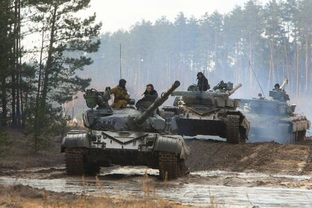 turrets: Soldiers show their skills driving T-64 tanks during the military drills on February 25, 2008  in Chernihiv region, Ukraine
