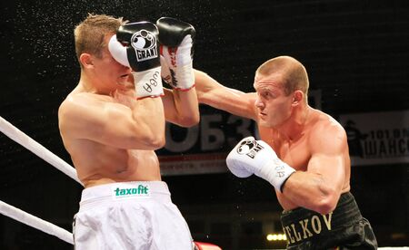 wba: KYIV, UKRAINE - JUNE 19, 2008: Vyacheslav Uzelkov  fights with  Slovenian Denis Simcic for the WBA Intercontinental light heavyweight on aprilchampion belt on June 14, 2008 in Kyiv, Ukraine