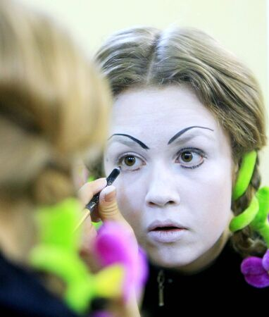 mime puts his makeup on getting ready for show called