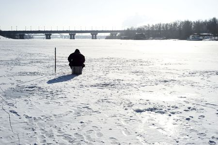 Winter fishing on the river in the sunshine day Stock Photo - 6402414